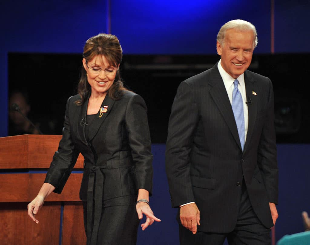 Sarah Palin and Democrat Joseph Biden walk on stage following their vice presidential debate