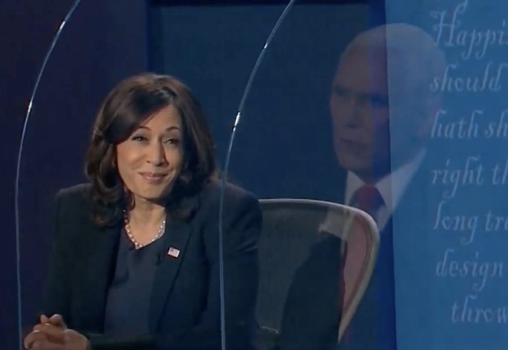 Kamala Harris smiling at Mike Pence