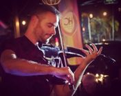 queer violinist drowns out homophobic trump supporters