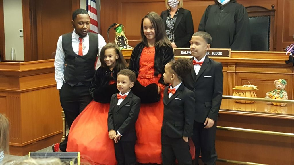 gay man adopts five children to keep family together