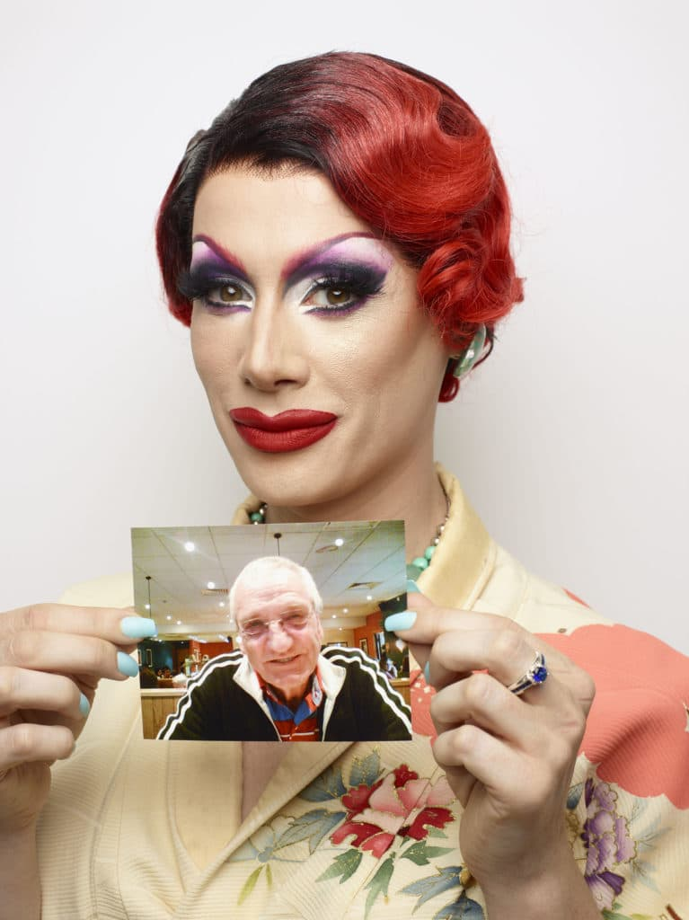 Divina De Campo holds a photo of her late father-in-law, Bob.