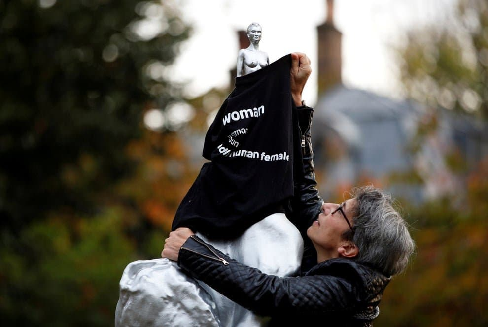 Julia Long drapes an anti- trans t-shirt on the new Mary Wollstonecraft statue