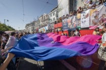 Participants display a bisexual pride flag during a 2019 pride parade in Lisbon, Portugal