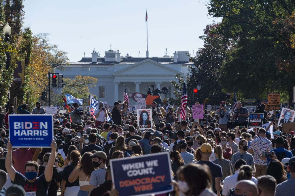 Crowds troll Donald Trump by dancing the YMCA outside the White House