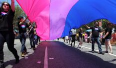 People marching with anBi, a bisexual organization, carry a bisexual flag in the LA Pride Parade