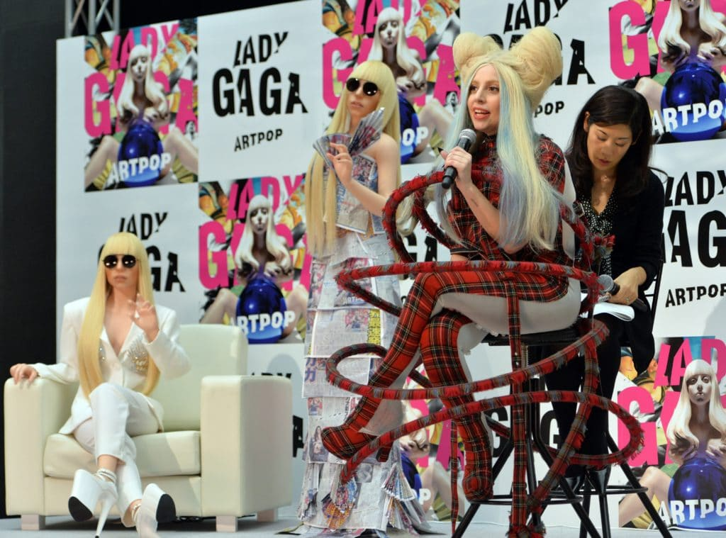 Lady Gaga (2nd-R) poses next to her look-alike doll called 'Gagadoll' made of silicon during a press conference. (YOSHIKAZU TSUNO/AFP via Getty Images)