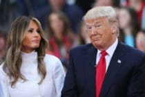 Donald Trump sits and his wife Melania Trump. (Spencer Platt/Getty Images)