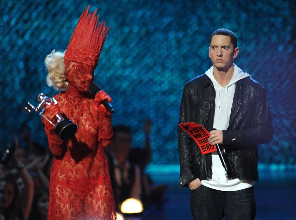Lady Gaga accepts an award onstage from rapper Eminem during the 2009 MTV Video Music Awards. (Kevin Mazur/WireImage)