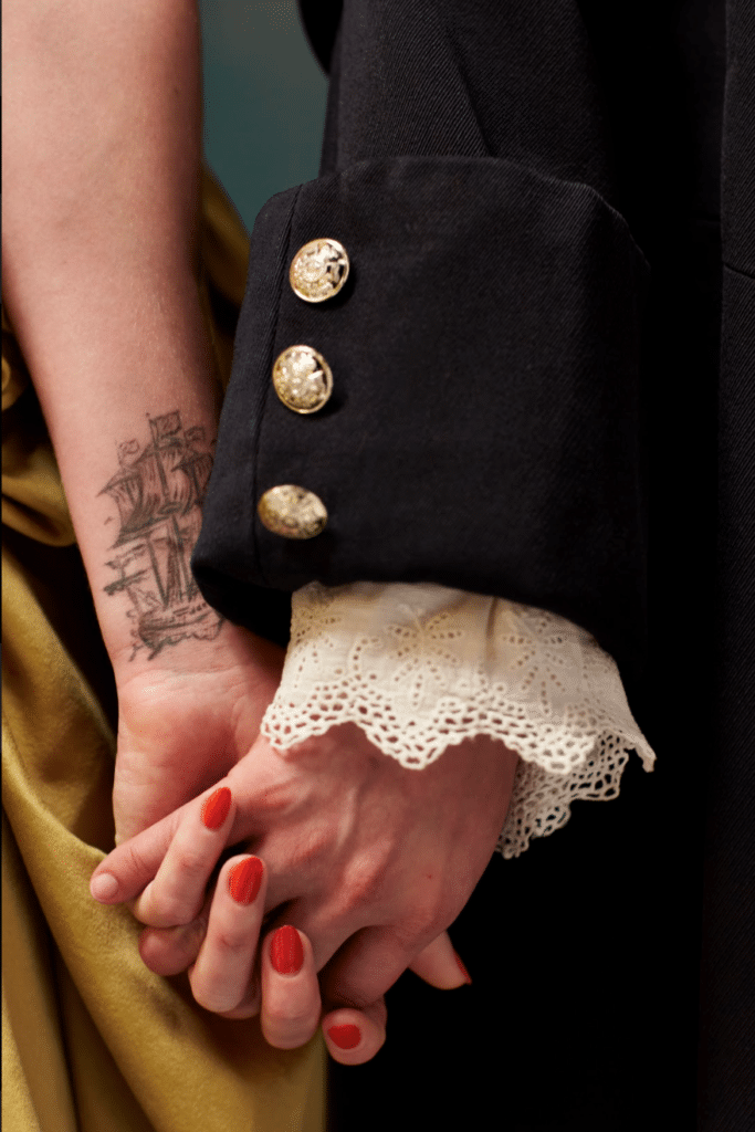 Close-up of two women holding hands