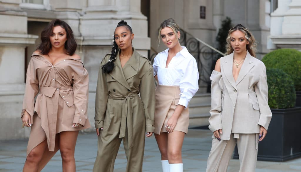 The four members of Little Mix standing on a London street