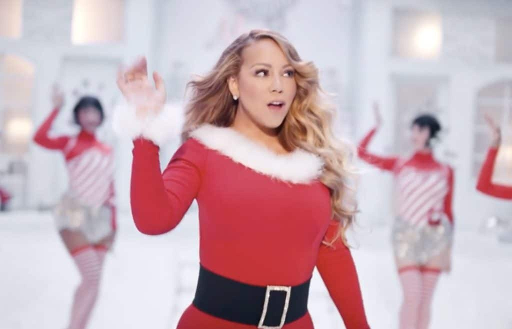 Mariah Carey performs 'All I Want For Christmas Is You' in a Santa-themed dress with festive back-up dancers behind her