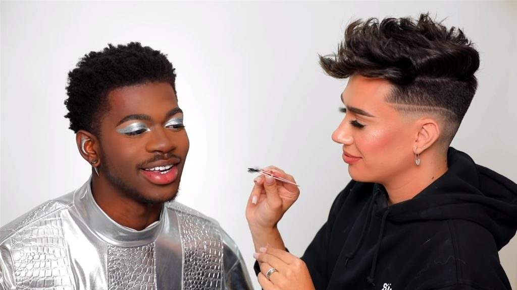 Lil Nas X getting his make-up done by James Charles