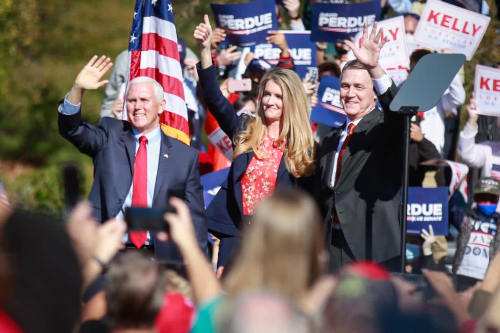 Mile Pence and Kelly Loeffler at a campaign rally