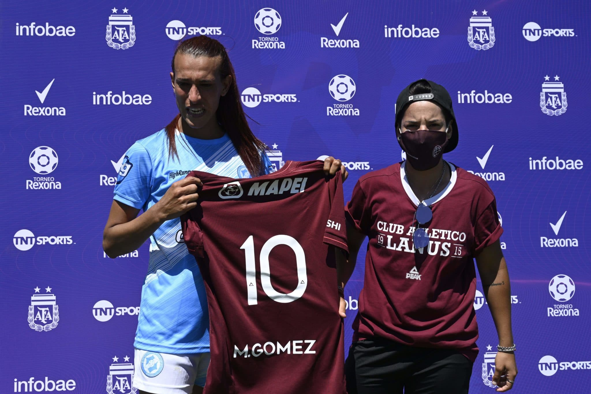 Mara Gómez poses with a jersey of Lanus with her name on it given as present after an Argentina first division female football match