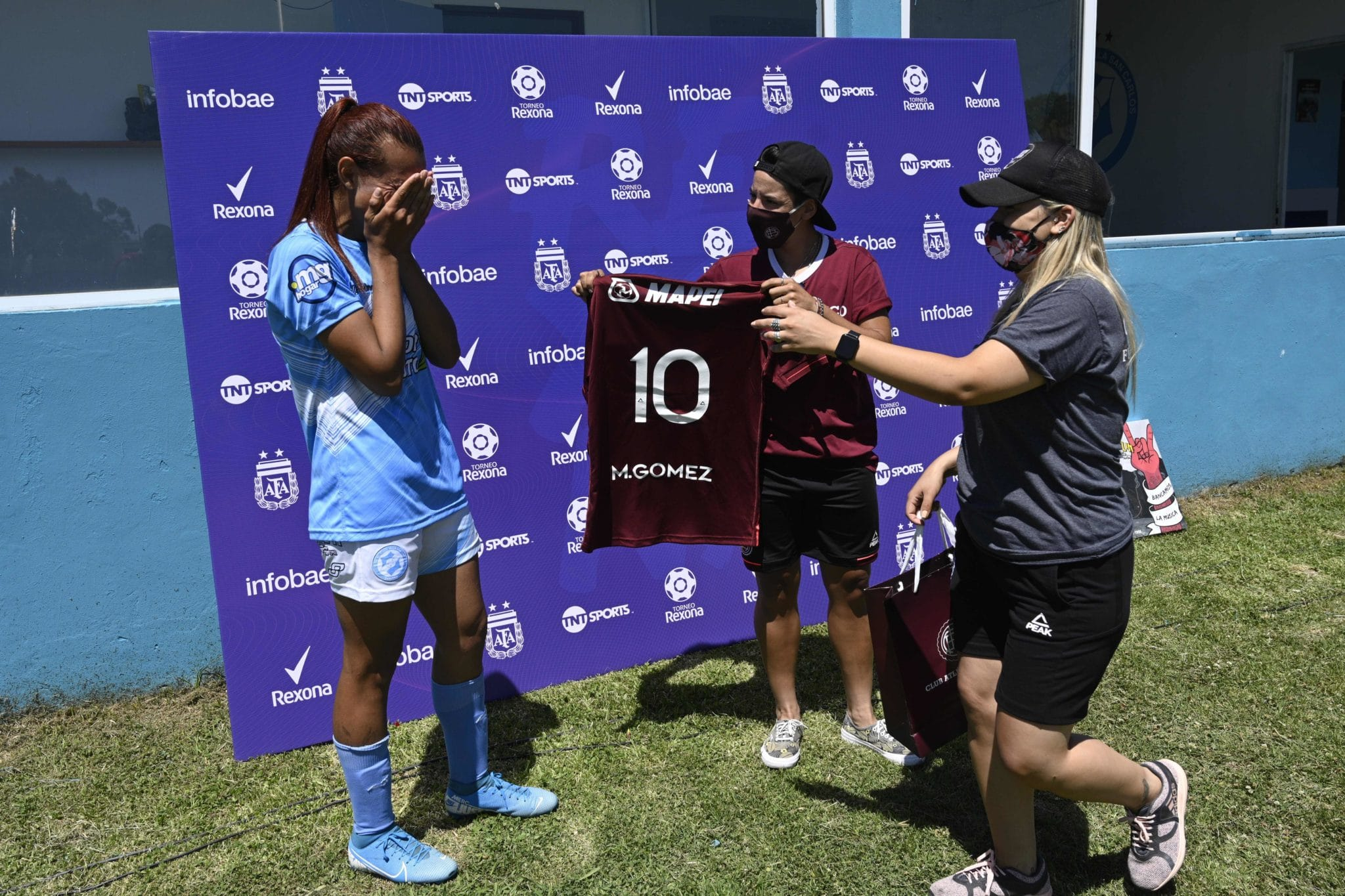 Mara Gomez of Villa San Carlos reacts emotionally as she is given a jersey of Lanus with her name on it