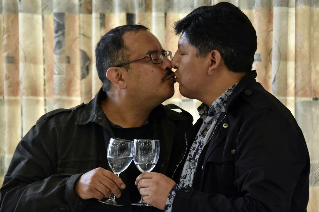 David Aruquipa kisses Guido Montano after Bolivia recognised their same-sex civil union