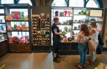 People wearing protective face masks shop in Lush in Bournemouth in June2020