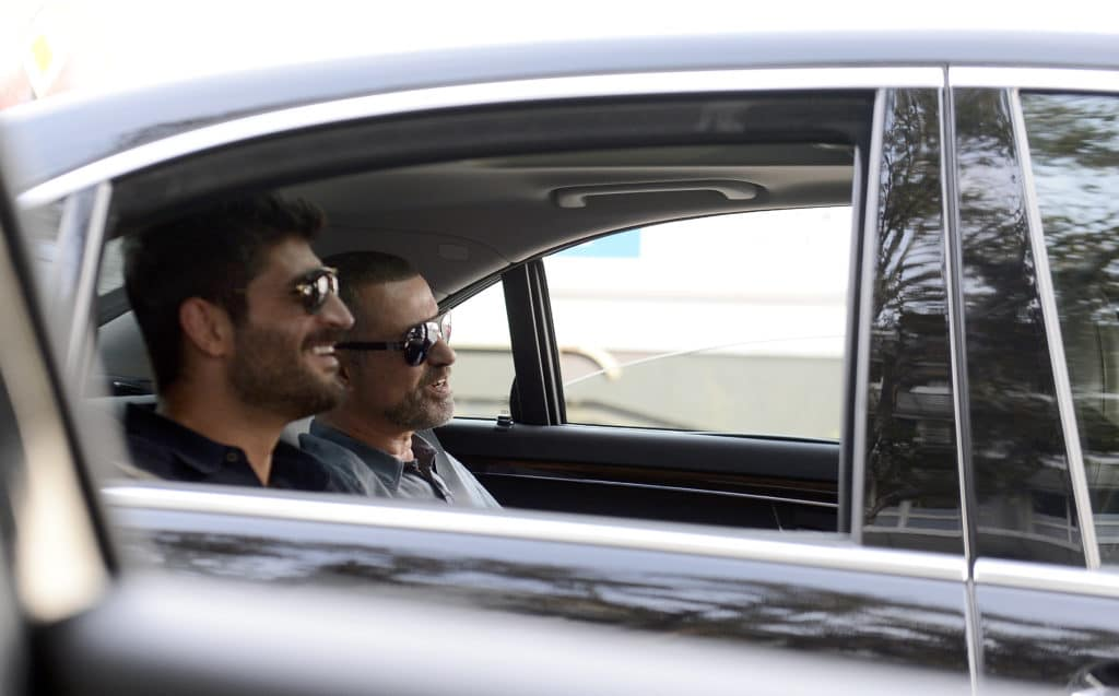 George Michael and Fadi Fawaz in the backseat of a car
