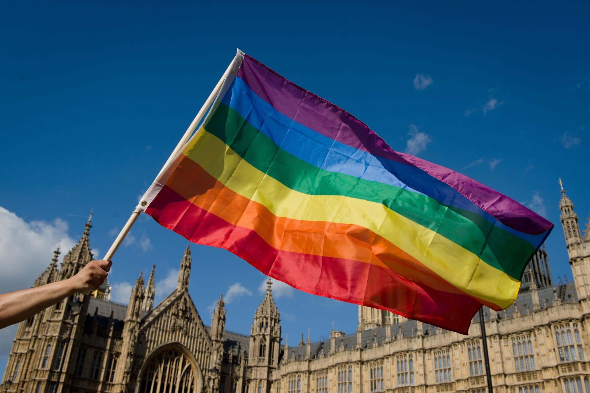 Pried flag held in front of the houses of parliament