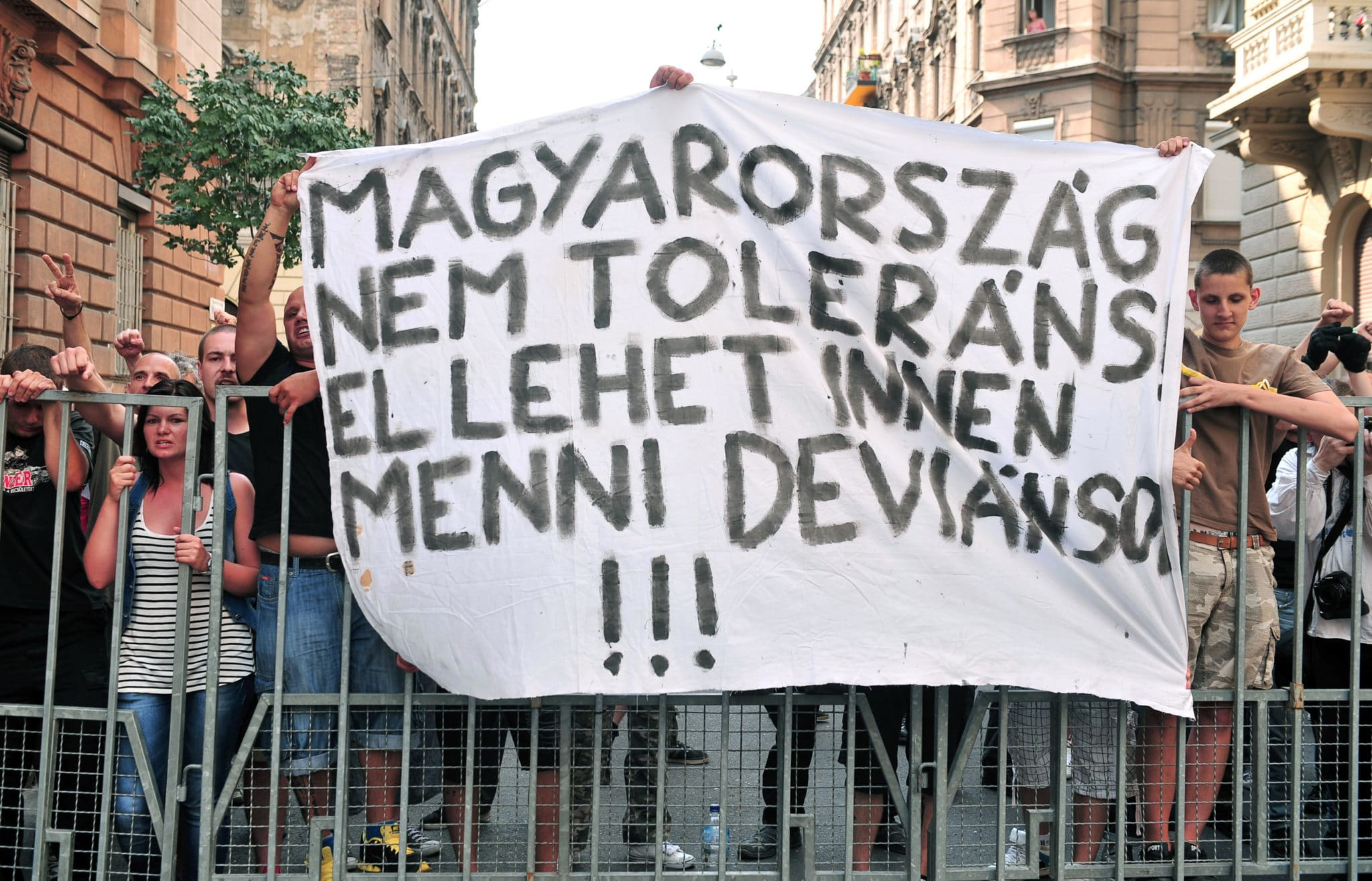 Nationalists hold a banner reading 'Hungary is not a tolerant country, go way deviants' during a Hungarian gay pride parade