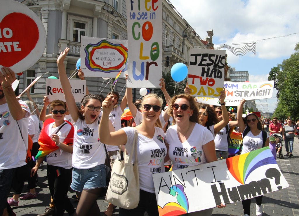 People hold flags and balloons as they take part in the Baltic Pride 2016 in Vilnius, Lithuania.