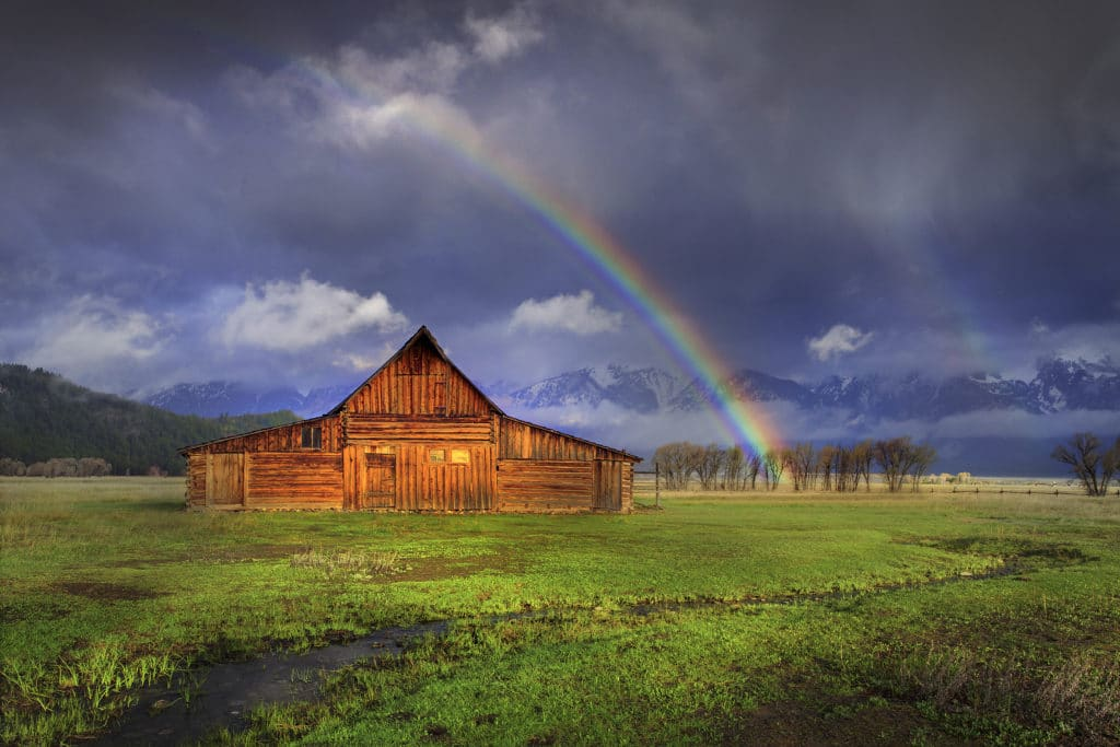 A rainbow over a barn in Wyoming