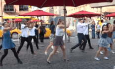 Mark in a flash mob proposal to Yuval