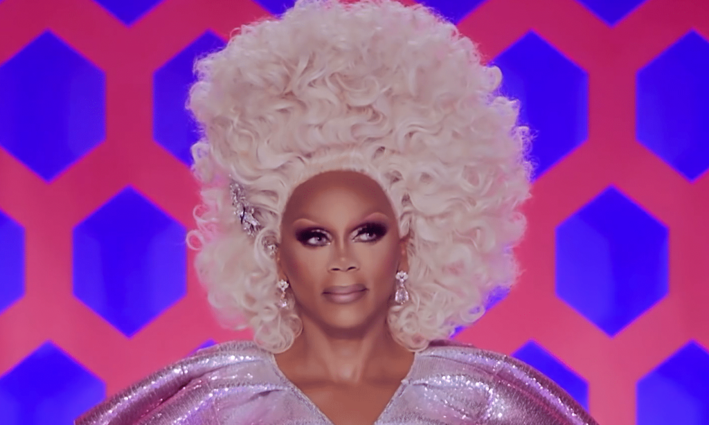 RuPaul in a tall curly blonde wig