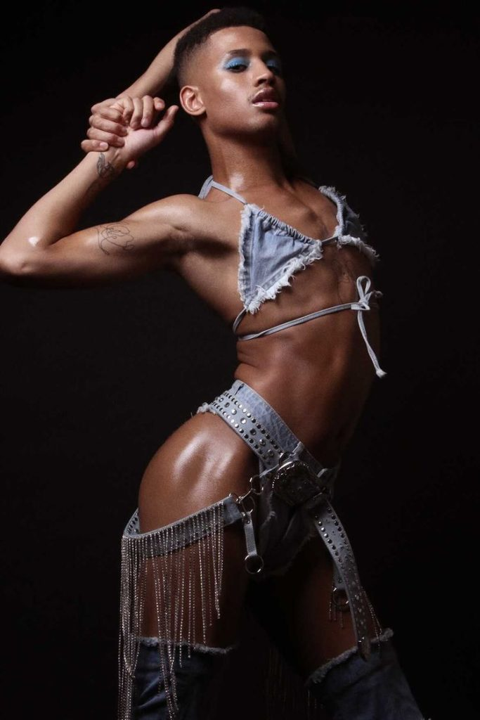 Tyreece Nye in a denim bikini top and a belt harness dripping with diamanté's