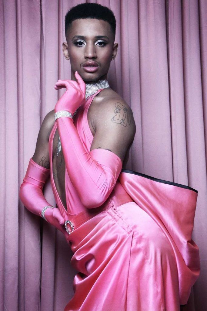 Tyreece in a pink satin gown with a big bow on the back
