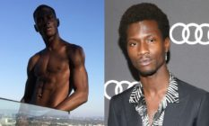Adonis Bosso topless standing against a skyline, a glass pane hiding his lower section