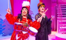 BenDeLaCreme dressed as a drummer with Jinkx Monsoon in a feather-trimmed nightgown