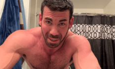 Billy Santoro topless, in a bathroom