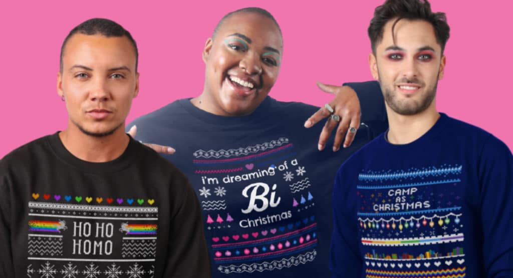 Three LGBT+ people wearing PinkNews' Christmas jumpers against a pink background