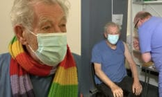 Ian McKellen receives the coronavirus vaccine while wearing a rainbow scarf and face mask