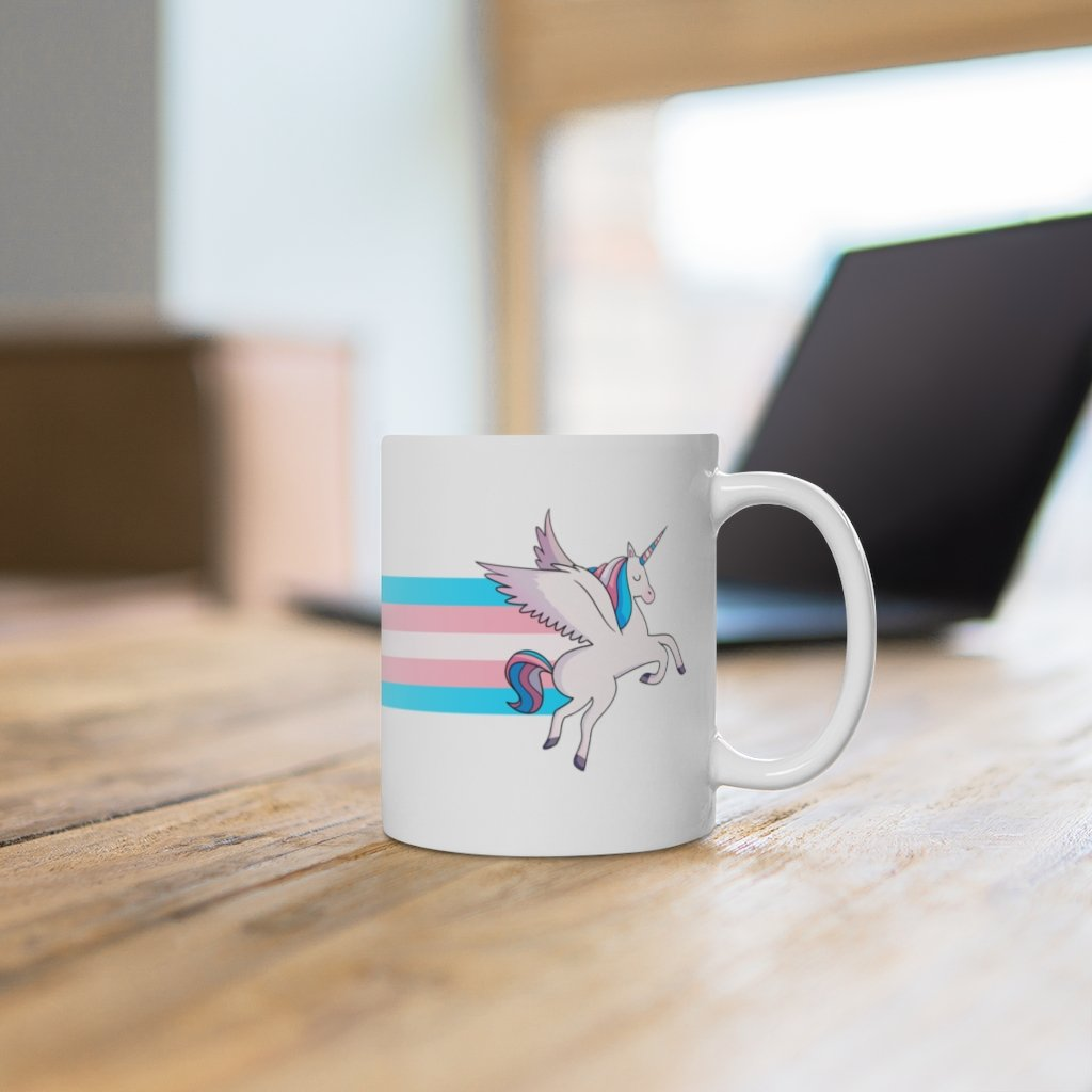 The trans flag unicorn rainbow mug available from the PinkNews store
