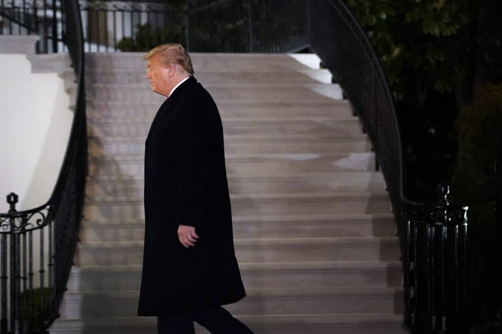 President Donald Trump walks to the White House residence on January 12