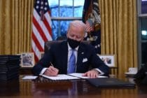 US president Joe Biden prepares to sign a series of orders in the Oval Office of the White House