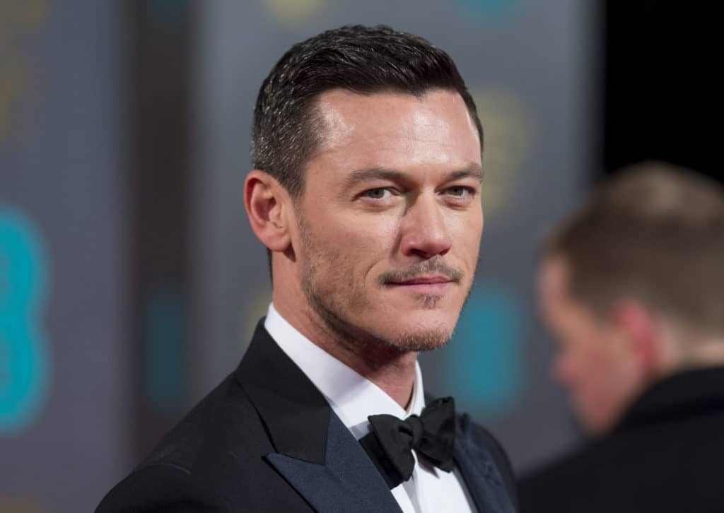 Luke Evans in a tuxedo, looking to his right