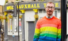 Philip Normal wearing a rainbow jumper standing outside the Royal Vauxhall Tavern