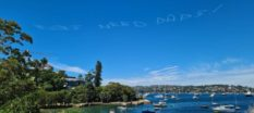 """message in aky above sydney Australia that says """"kids need dads"""""""