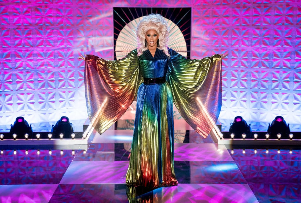 RuPaul in a long-sleeved kaftan in the colours of the rainbow
