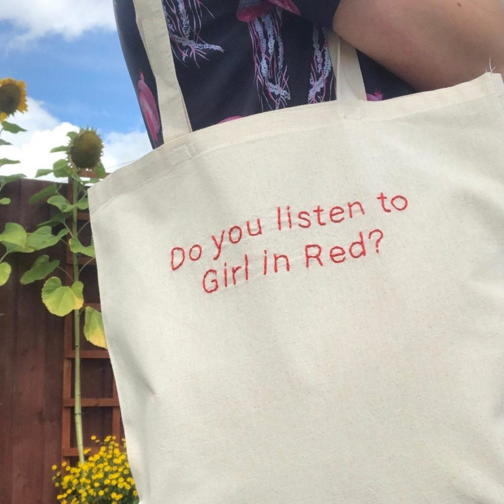 An embroidered tote bag for fans of girl in red.