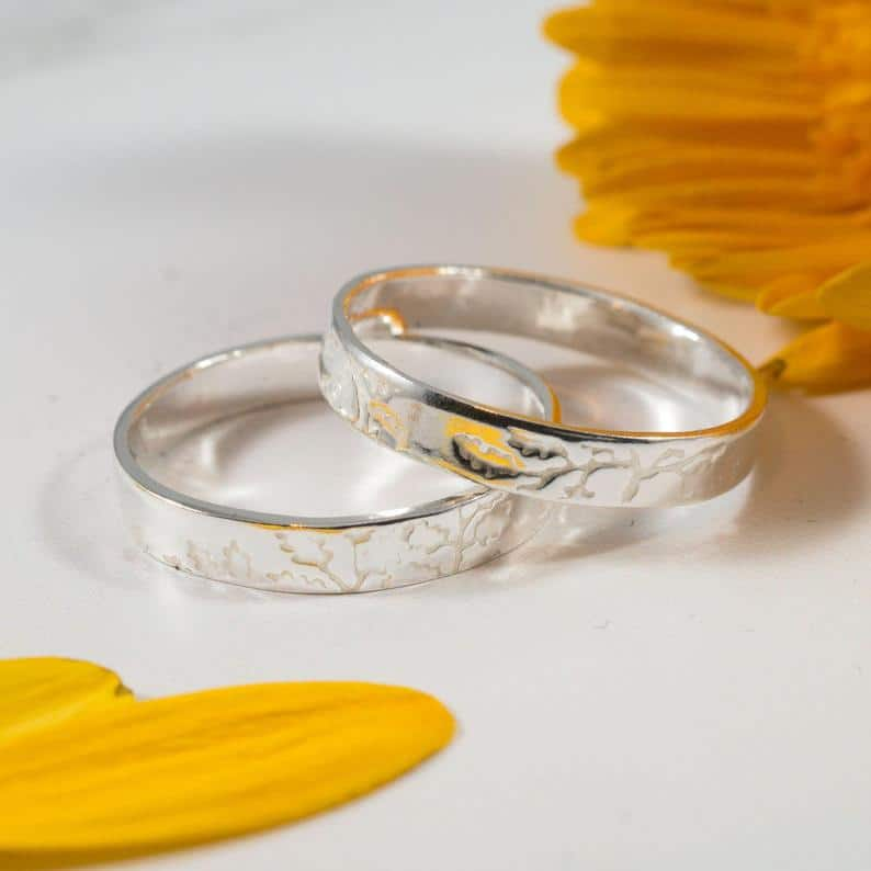 Wedding bands that feature an oak print. (Etsy/FragmentDesignsEtsy)