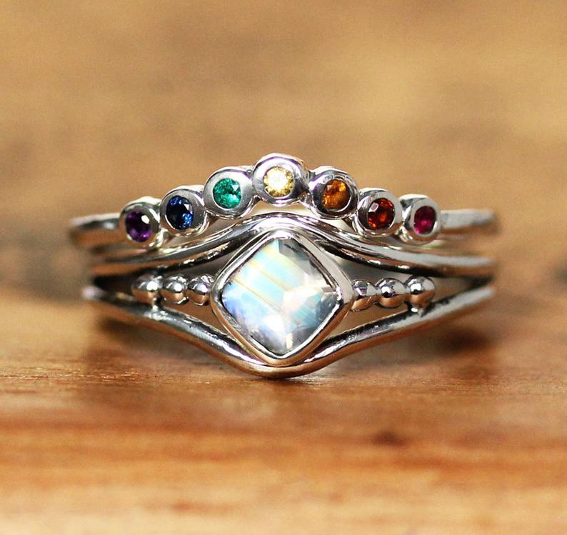 A stacked rainbow wedding ring that looks similar to a crown or tiara. (Etsy/metalicious)