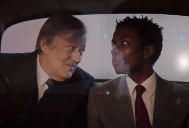 Stephen Fry and Omari Douglas (Arthur and Roscoe) in the back of a cab