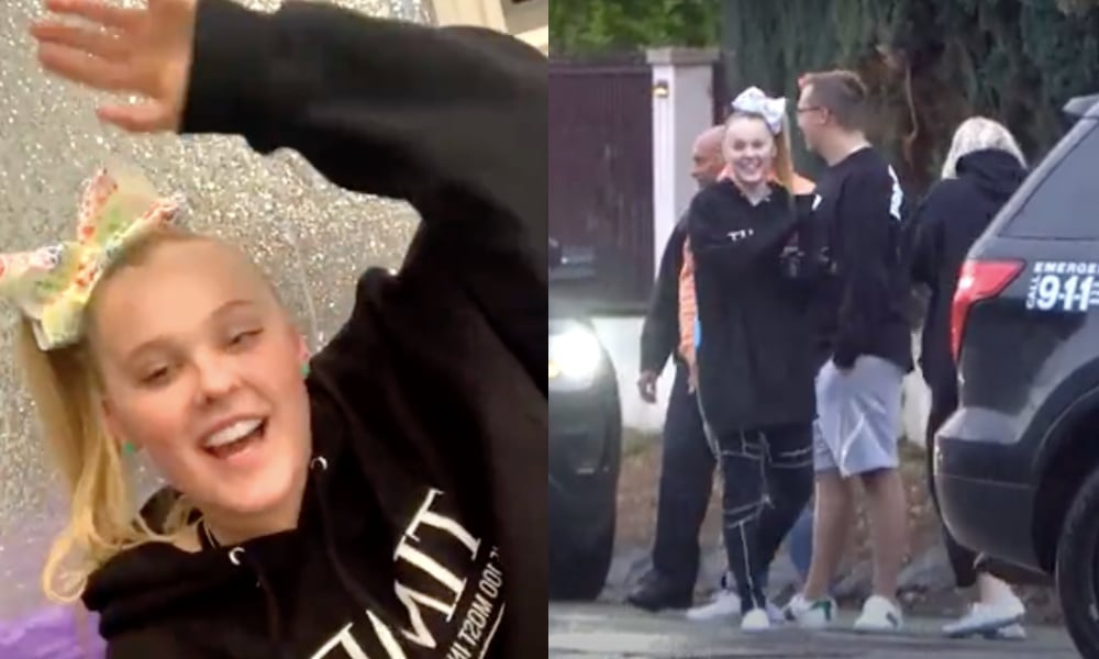 (R) Jojo Siwa smiles and waves in a black swarthiest. (R) JoJo Siwa speaks to police officers with a LAPD car by her