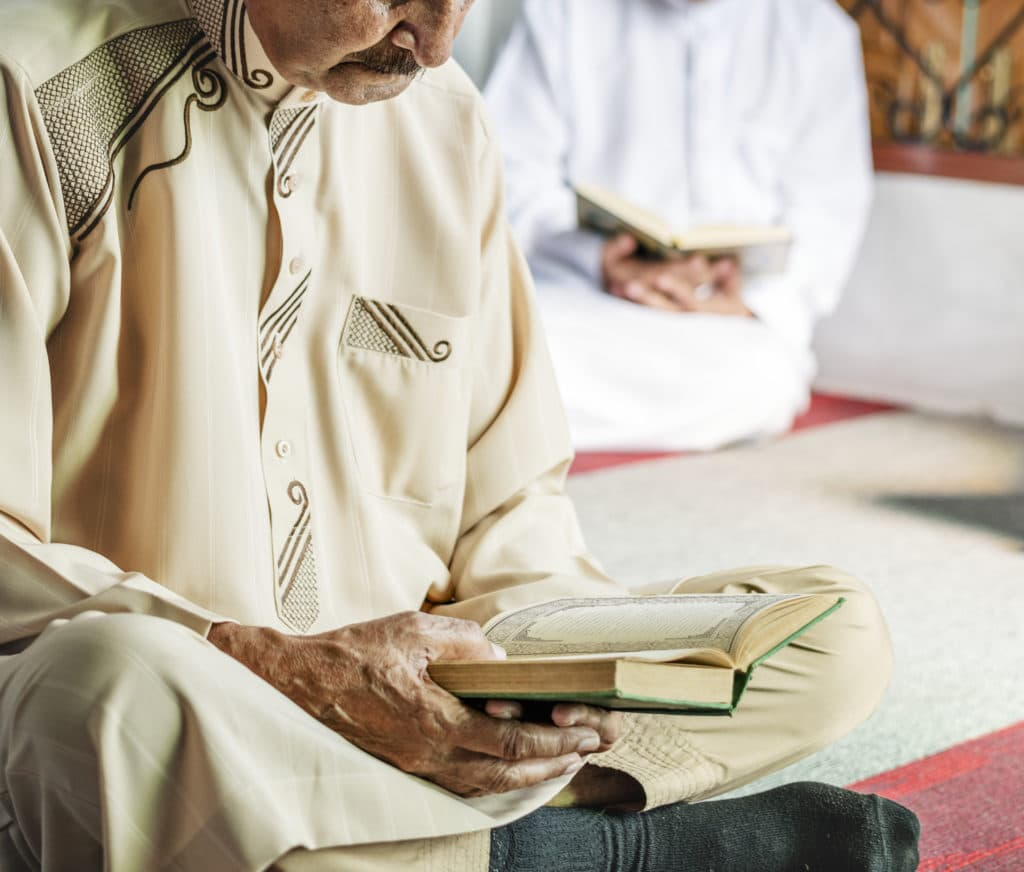 A muslim man reading from the quran