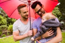 Gay dads with their child
