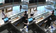 A man in a white shirt and tie grabs and throws an LGBT+ Pride flag at staff behind the counter of a food stall